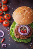 Home made burger cooking Royalty Free Stock Photography