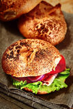 Home made burger on the rustic tissue. Buns on the background. Royalty Free Stock Photography