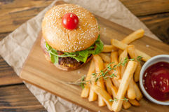 Home made burgers on wooden background Royalty Free Stock Image