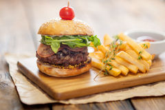 Home made burgers on wooden background Stock Image