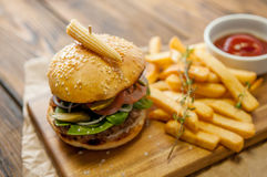 Home made burgers on wooden background Stock Photo