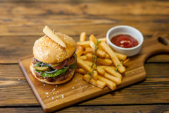 Home made burgers on wooden background Royalty Free Stock Photos