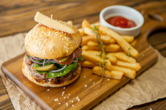 Home made burgers on wooden background Royalty Free Stock Photography