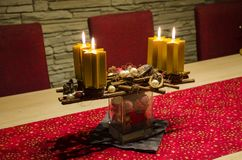 Home made burning advent candlestick on the Xmas table stock photos
