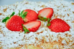Strawberry pie. Home made  cake decorated with fresh strawberry and  sugar powder Stock Photography