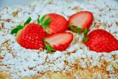 Strawberry pie. Home made  cake decorated with fresh strawberry and  sugar powder Stock Photos