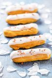 Home made cake eclairs. Traditional eclairs, profitroles classic, eclairs french stock image