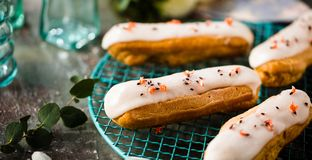 Home made cake eclairs. Traditional eclairs, profitroles classic, eclairs french royalty free stock images