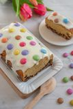 Home made cake with smarties. Home made sweet pound cake with smarties on  a table Royalty Free Stock Photography
