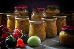 Home-made canned vegetables in glass jars royalty free stock photos