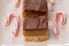 Home Made Caramel Treats with Candy Canes. Home made caramel treat bars with candy canes for Christmas Stock Photo