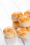 Home made cheese scones on white wood Royalty Free Stock Photos