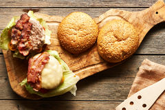 Home made cheeseburgers on wooden table Royalty Free Stock Photo