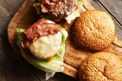 Home made cheeseburgers on wooden table Stock Photo
