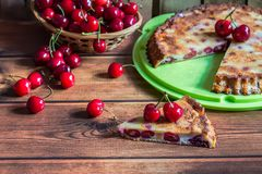 Home made cherry cake with vanilla and black cherries on wooden table royalty free stock photo