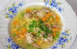 Poultry broth with noodles and liver dumplings stock image