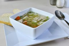 Home-made Chicken Noodle Soup 2. Authentic Home-made Chicken Noodle Soup. Lean chicken breast, seasoned, grilled and sliced evenly in flavored broth with carrots Stock Image