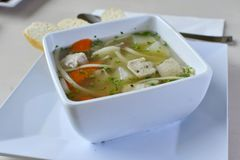 Home-made Chicken Noodle Soup 4. Authentic Home-made Chicken Noodle Soup. Lean chicken breast, seasoned, grilled and sliced evenly in flavored broth with carrots Stock Photos