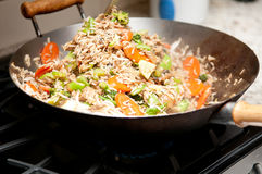 Home made chicken stir fry. Wok fried chicken stir fry with rice and chinese vegetables Stock Photography
