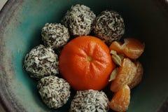 Home-made choco balls. With madarine juice Stock Photos
