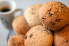 Home made.chocolate chip muffins with a cup of coffee Stock Image