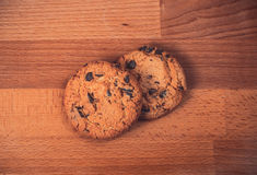 Home made chocolate cookies on wooden background. Crispy chip biscuits with chocolate and hazelnuts. stock images