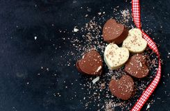 Home made chocolate dark and white hearts and ribbon stock images