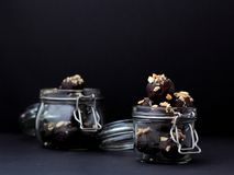 Home-made chocolates in jars royalty free stock photography