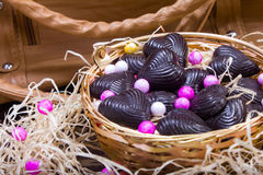 Home made chocolates in metal basket with purse Royalty Free Stock Photos