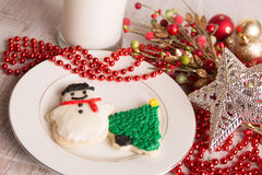 Home made Christmas cookies and decorations. Home made Christmas cookies with decorations and milk Stock Image