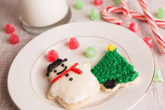 Home made Christmas cookies and decorations. Home made Christmas cookies with gumdrops and milk Stock Photo