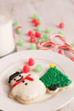Home made Christmas cookies and gumdrops. Home made Christmas cookies with gumdrops, candy canes and milk Royalty Free Stock Image