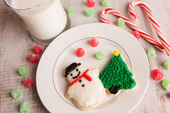 Home made Christmas cookies and gumdrops. Home made Christmas cookies with gumdrops, candy canes and milk Royalty Free Stock Photos