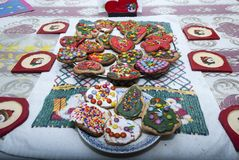 Home made Christmas cookies. Xmas cookies decorated served on dishes on a table Stock Photography