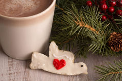 Home made Christmas dove heart cookie with hot chocolate. And evergreen boughs Stock Photography