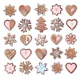 Christmas gingerbread cookies collection set isolated. Home made Christmas gingerbread cookies icing decoration collection isolated on white stock photography