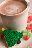 Home made Christmas tree cookie with hot chocolate. Home made Christmas tree cookie, gumdrops and hot chocolate on a plate close up vertical Stock Images
