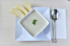 Home-made Clam Chowder 3. Authentic Home-made Clam Chowder with seasonings and spices garnished with parsley and home-made white bread on the side Stock Image