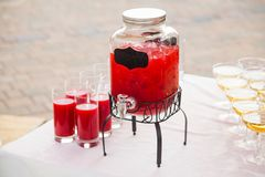 Home-made compote of raspberries in a transparent jug. Home-made compote of raspberries in  transparent jug Stock Photo