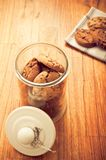 Home made cookies biscuits with cacao chips in glass jar in rustic style. On wooden background like sweet, healthy cereal dessert, food concept, sweets and home stock photos