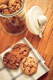 Home made cookies biscuits with cacao chips in glass jar in rustic style. On wooden background like sweet, healthy cereal dessert, food concept, sweets and home stock photo