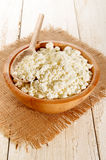 Home made cottage cheese with wooden spoon in a wooden bowl Royalty Free Stock Image