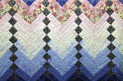 Home Made Country Quilt in Blue and Pink Patchwork Royalty Free Stock Photos
