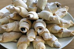 Home made crescent rolls stuffed with plum jam Stock Photo