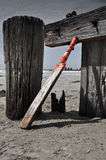 Home made cricket bat on the beach Royalty Free Stock Images
