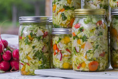 Home made cultured or fermented vegetables. In glass jars stock photo