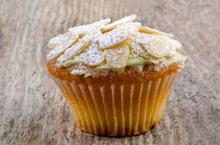 Home made cup cake with almond flakes Stock Photo