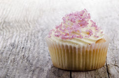Home made cup cake on a timber board Stock Photography