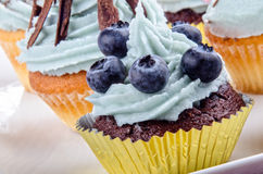 Home made cupcake with blue buttercream Stock Photo