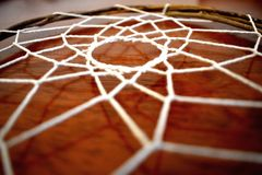 Home Made Dream Catcher. A home made dream catcher, woven with vine stock image